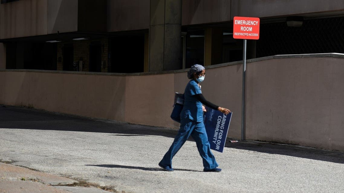 A healthcare worker leaves Houston Methodist Hospital, as social distancing guidelines to curb the spread of the coronavirus disease (COVID-19) are relaxed in Houston, Texas. (Reuters)