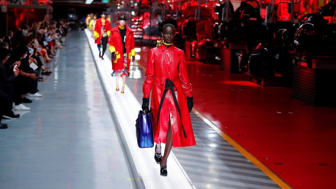 Models present outfits from luxury carmaker Ferrari's first internally-designed fashion collection for women and men as the first step of its rebooted brand extension strategy, in Maranello, Italy, June 13, 2021. (Reuters/Remo Casilli)