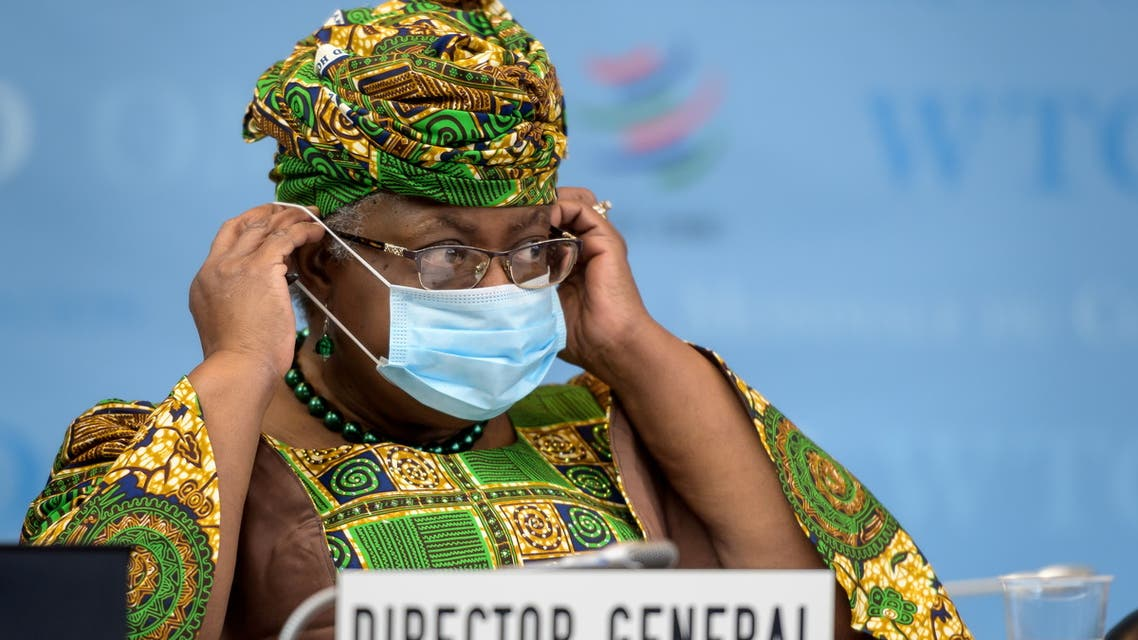New Director-General of the World Trade Organisation Ngozi Okonjo-Iweala adjusts her face mask as a preventive measure against the COVID-19 coronavirus disease during a session of the WTO General Council upon her arrival at the WTO headquarters to take an office in Geneva, Switzerland March 1, 2021. (Reuters)