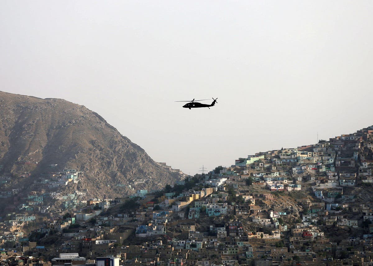 A NATO helicopter flies over the city of Kabul, Afghanistan June 29. 2020. (Reuters)