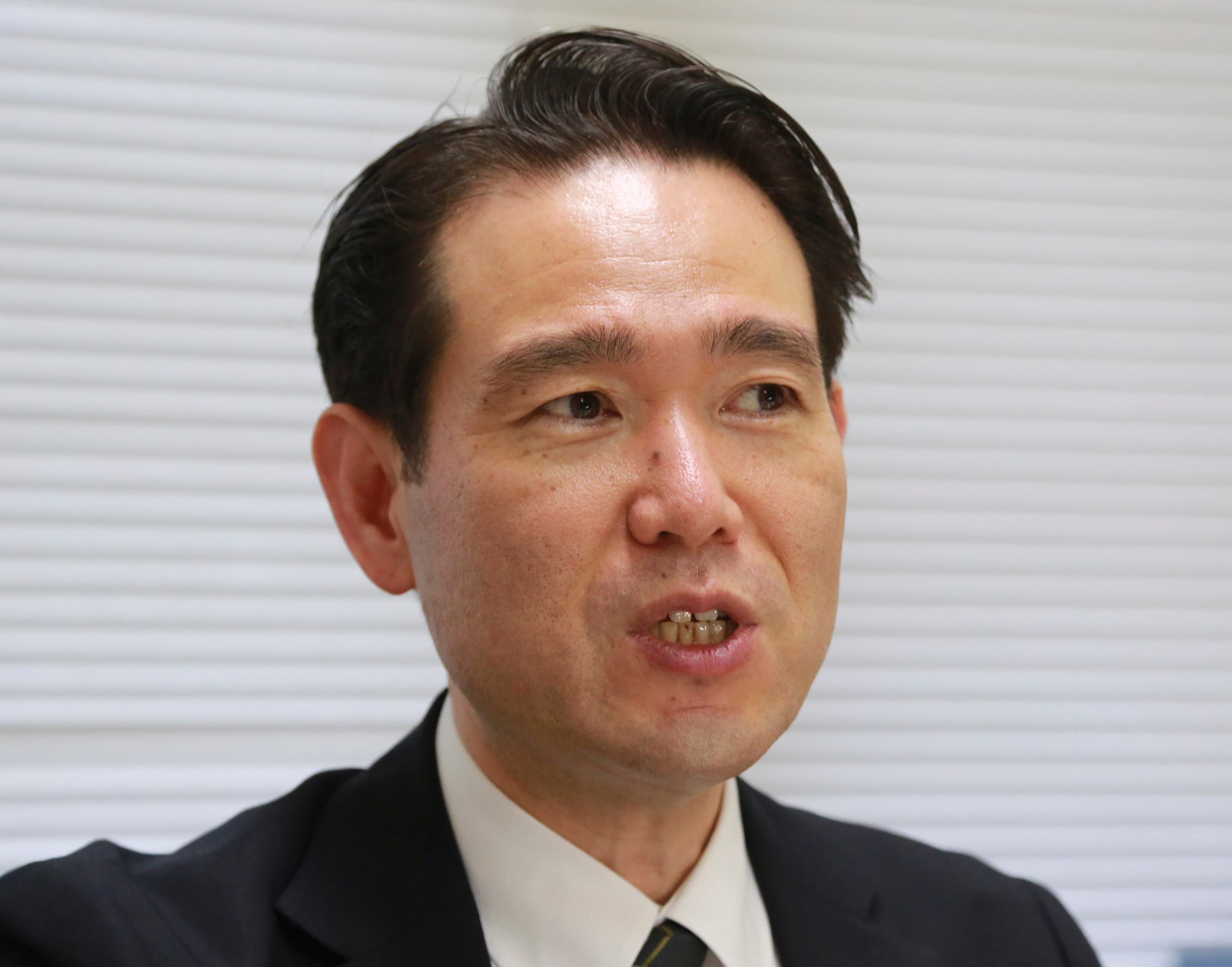 Professor Hiroaki Takazawa of Nihon University, speaks during an interview with the Associated Press in Chiba, near Tokyo on June 8, 2021. Takazawa has revealed declassified documents showing executed wartime Japanese Prime Minister Hideki Tojo's cremated ashes were scattered from a U.S. army aircraft over the Pacific Ocean about 30 miles (50 kilometers) east of Yokohama, Japan's second largest city. (File photo: AP)