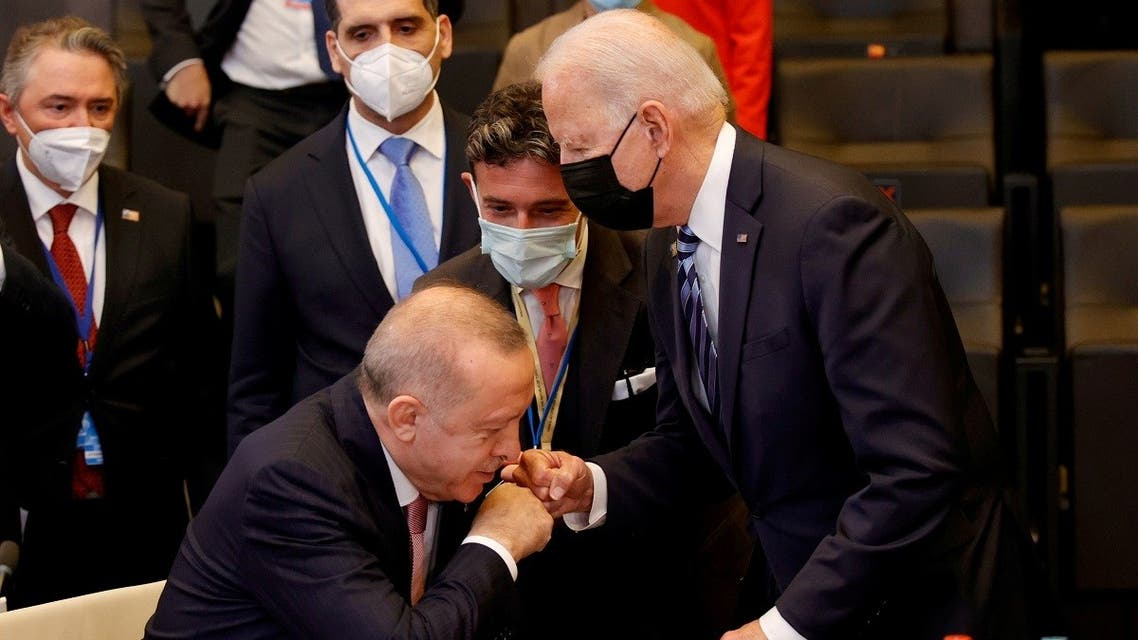 Turkey's President Recep Tayyip Erdogan rises from his chair to fist bump US President Joe Biden in Brussels, Belgium, June 14, 2021. (Reuters)