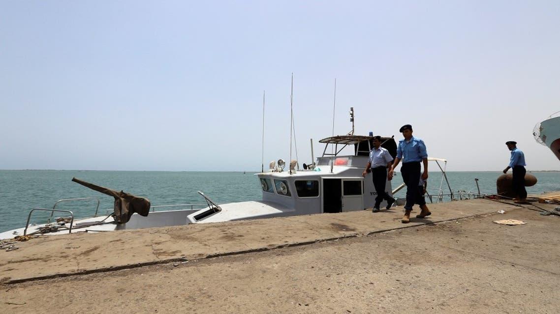 Yemeni local coast guards walk after being deployed at Hodeidah port in Hodeidah, Yemen. (Reuters)