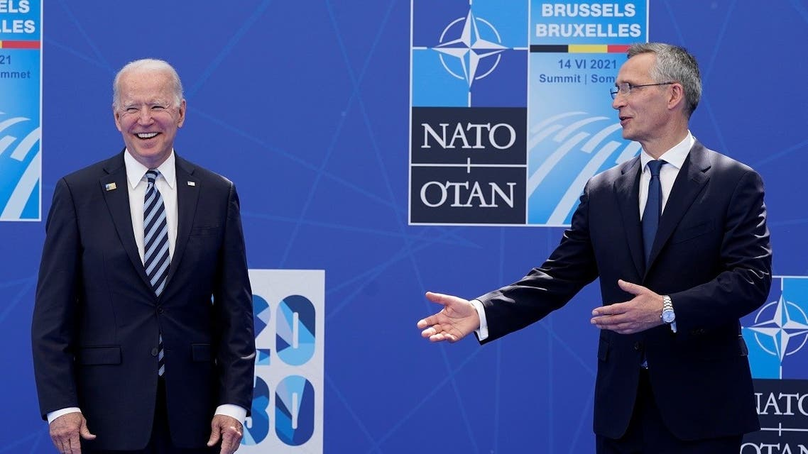 NATO Secretary General Jens Stoltenberg and US President Joe Biden pose during the NATO summit at the Alliance's headquarters, in Brussels, Belgium, June 14, 2021. (Reuters)