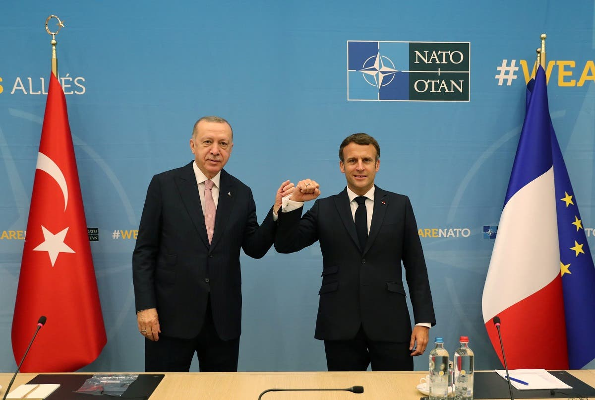 Turkish President Tayyip Erdogan meets with his French counterpart Emmanuel Macron during a bilateral meeting, on the sidelines of the NATO summit, in Brussels, Belgium June 14, 2021. (Reuters)