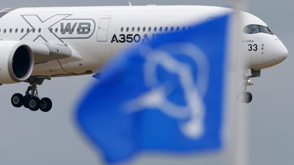 An Airbus A350 flies over a Boeing flag while landing after a flying display during the 51st Paris Air Show at Le Bourget airport near Paris, June 18, 2015. (File Photo: Reuters)
