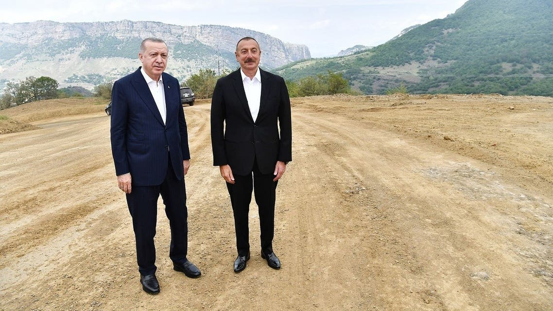 A handout picture taken and released on June 15, 2021 by the Azerbaijan's presidential press service shows Turkish President Tayyip Erdogan (L) meeting with Azerbaijani President Ilham Aliyev (R) in Nagorno-Karabakh region. (Azerbaijani Presidential Press Office/AFP)