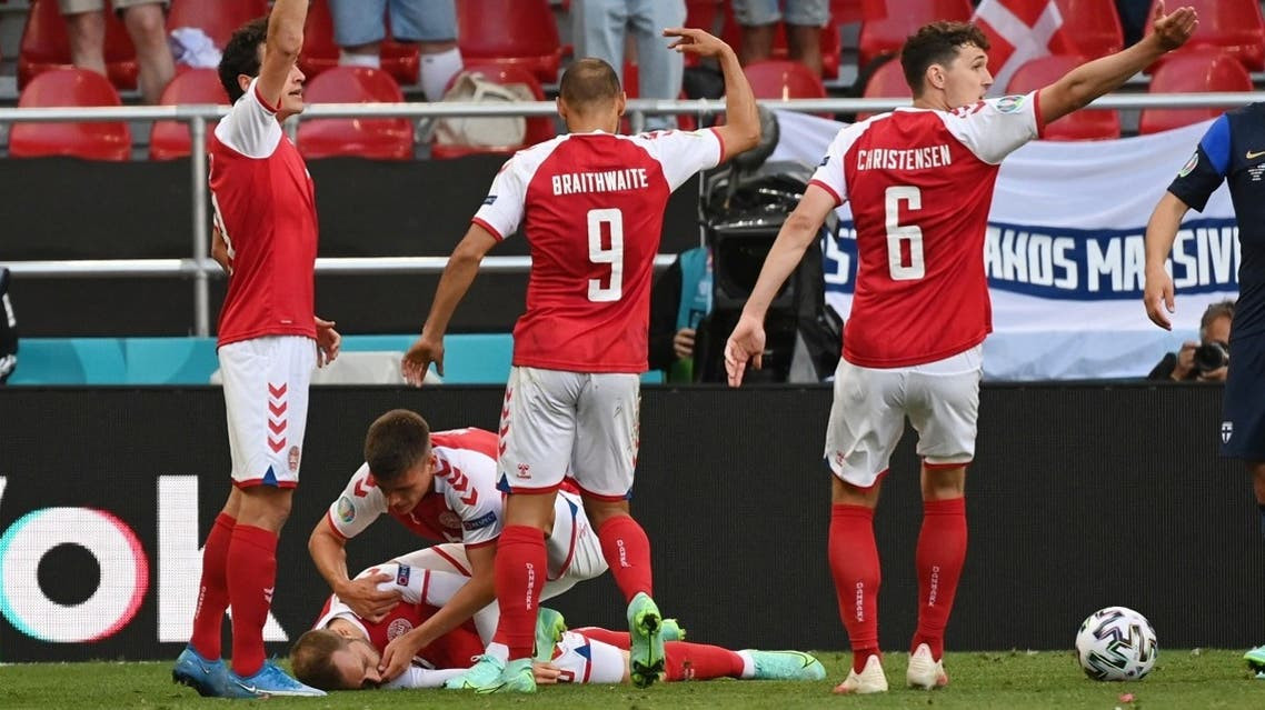 Denmark's Christian Eriksen receives medical attention after collapsing during the match on June 12, 2021. (Reuters)