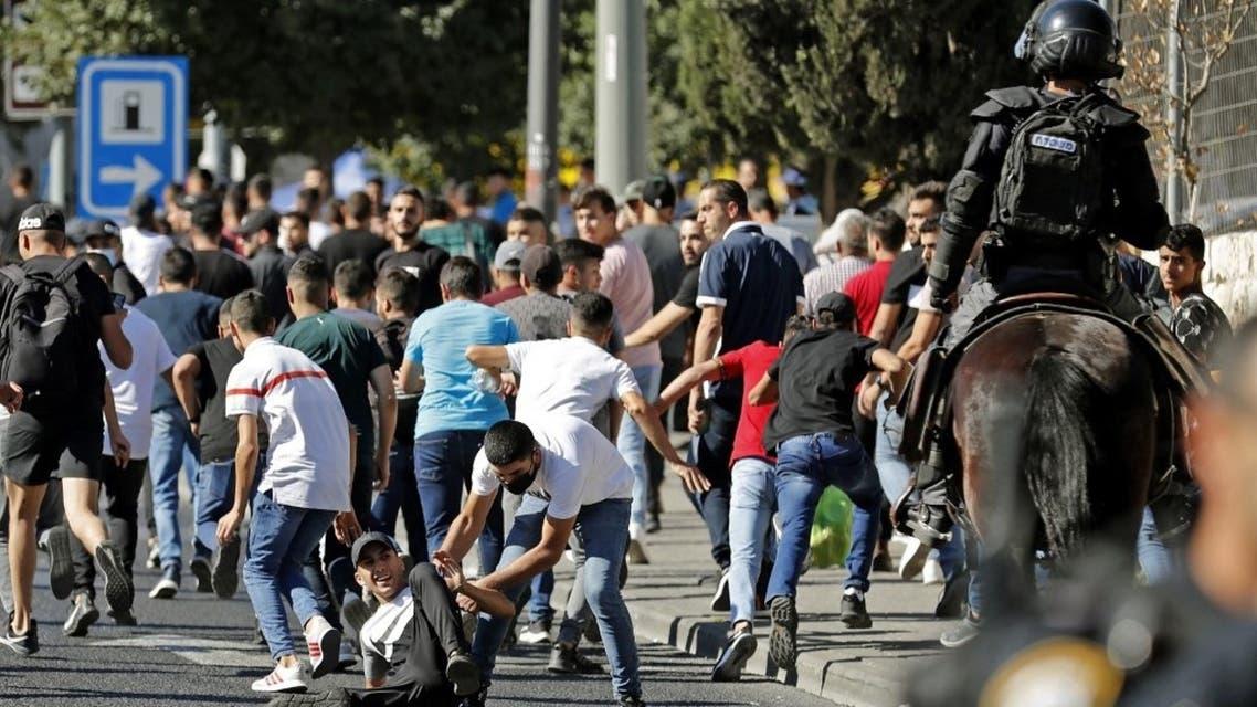 بدء مسيرة الأعلام واشتباكات بين فلسطينيين والقوات الإسرائيلية في القدس