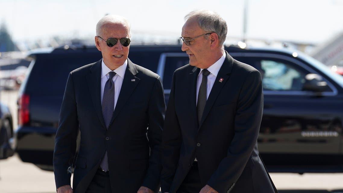 Swiss President Guy Parmelin welcomes U.S. President Joe Biden at Cointrin airport, as he arrives ahead of a meeting with Russian counterpart Vladimir Putin, in Geneva, Switzerland, June 15, 2021. (Reuters)