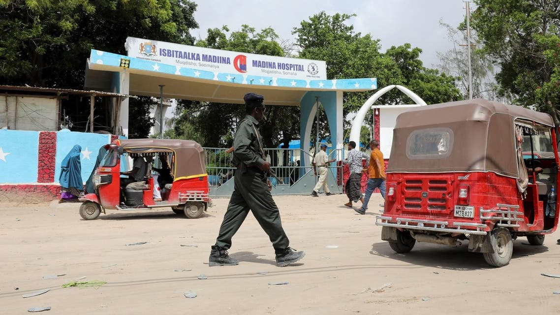An armed security man walks outside the Madina Hospital that treats people injured in a suicide bombing attack at a military base, in Mogadishu, Somalia June 15, 2021. (Reuters)