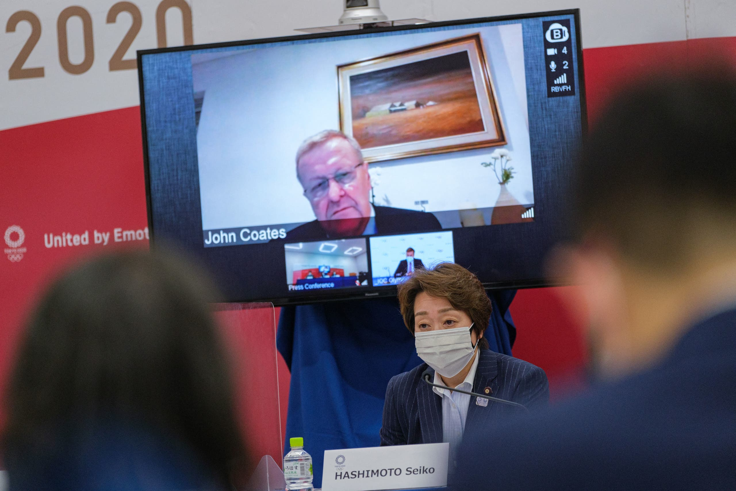 Tokyo 2020 CEO Toshiro Muto (L), Tokyo 2020 Olympics organising committee president Seiko Hashimoto (R) and International Olympic Committee (IOC) vice president John Coates (on screen) attend a Tokyo 2020 IOC Coordination Commission press conference in Tokyo on May 21, 2021. (File photo: AFP)
