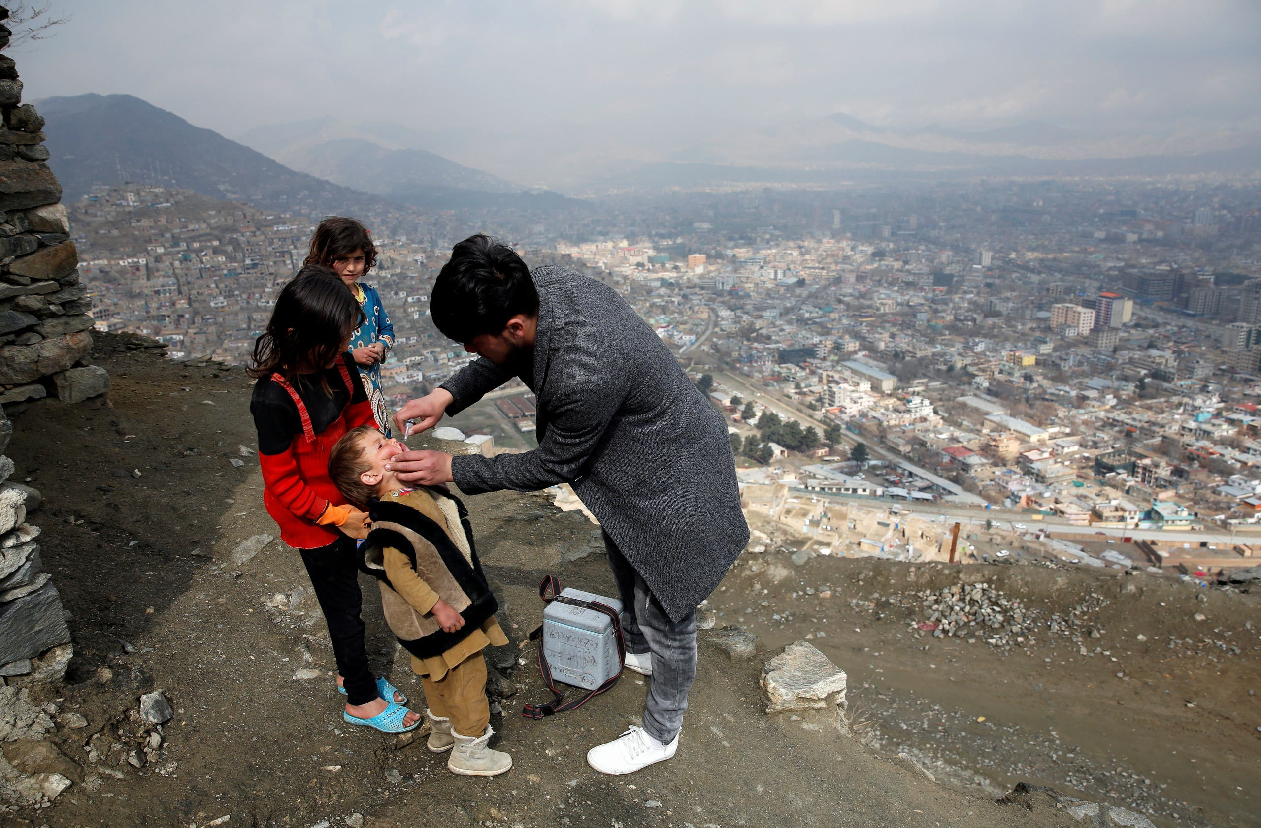 A boy receives polio vaccination drops during an anti-polio campaign in Kabul, Afghanistan March 14, 2018. (Reuters)