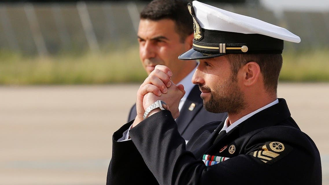 Italian sailor Salvatore Girone (R) reacts after landing at Ciampino airport in Rome, Italy, on May 28, 2016. (Reuters)