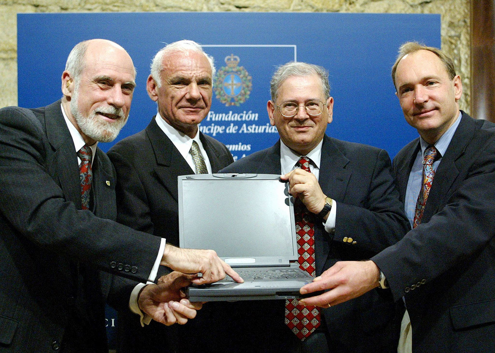 US's Vinton Cerfy (L), Lawrence Roberts (2nd L), Robert Kahn (2nd R) and British Tim Berners-Lee (R) pose for photographers after their joint news conference in Oviedo, northern Spain on October 24, 2002. (Reuters)