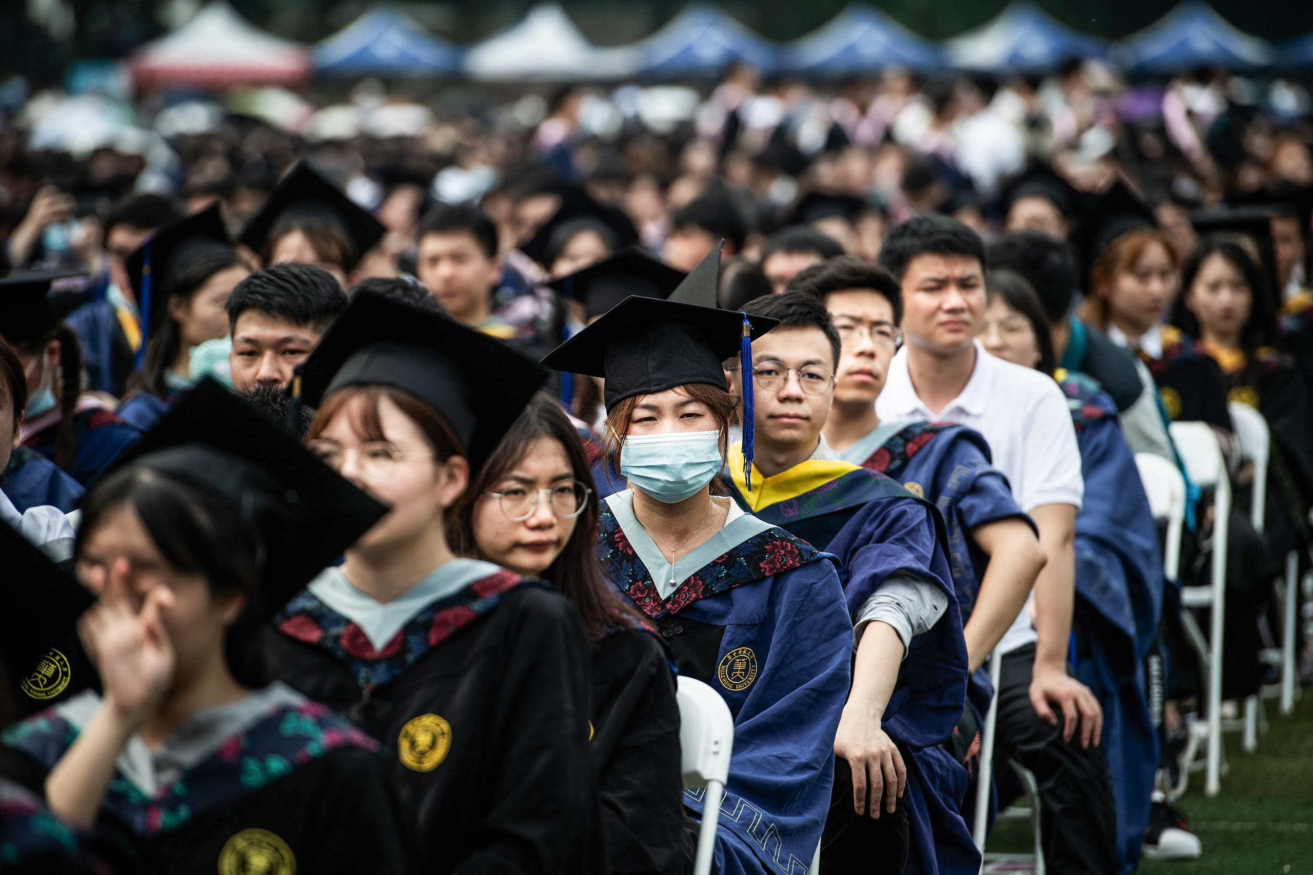 This photo taken on June 13, 2021 shows nearly 11,000 graduates, including more than 2000 students who could not attend the graduation ceremony last year due to the COVID-19 coronavirus outbreak, attending a graduation ceremony at Central China Normal University in Wuhan, in China's central Hubei province. (AFP)
