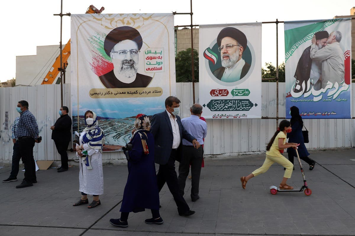 Banners of presidential candidate Ebrahim Raisi are seen during an election rally in Tehran, Iran June 14, 2021. (Majid Asgaripour/WANA (West Asia News Agency) via Reuters)