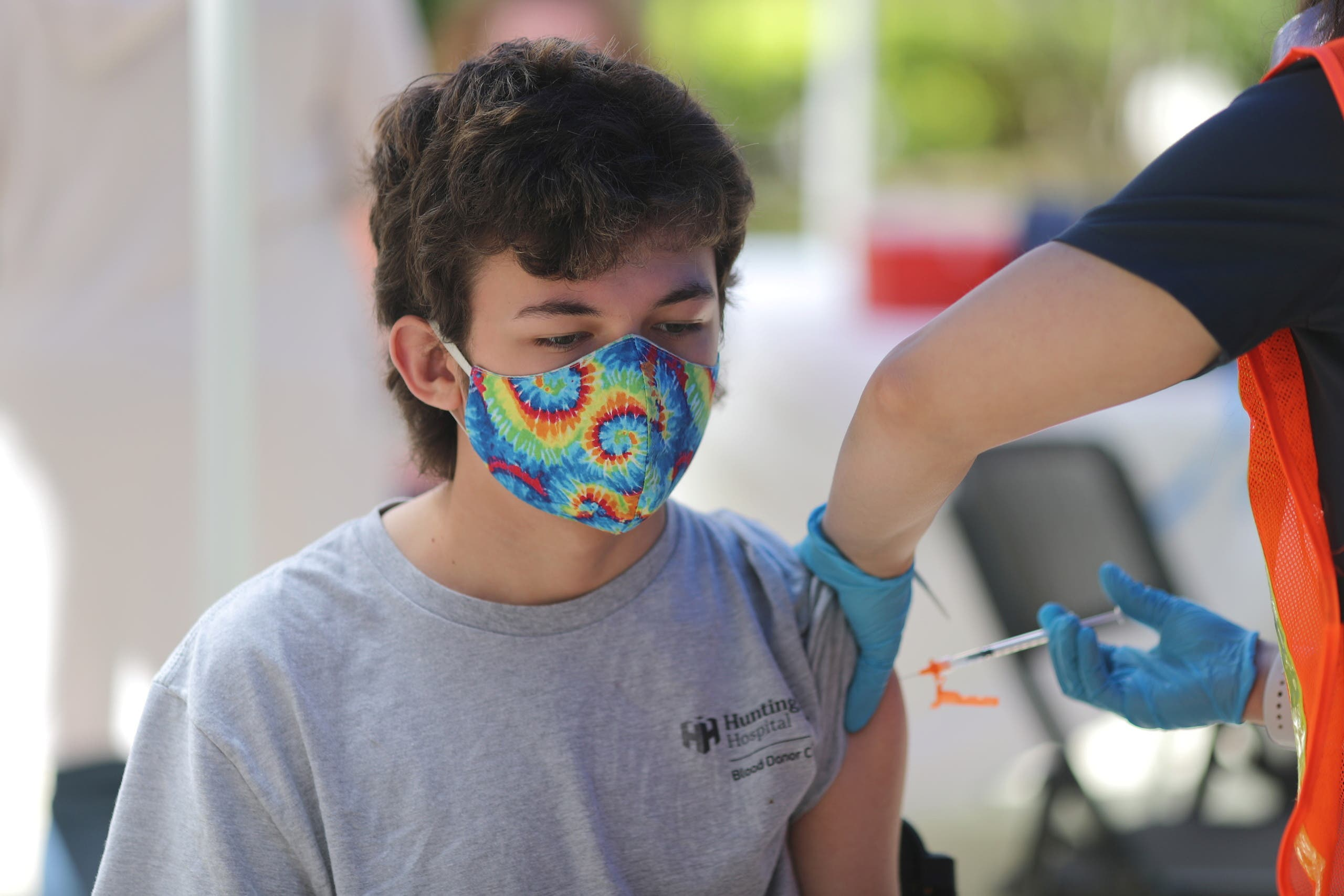Finley Martin, 14, receives a coronavirus disease (COVID-19) vaccination at a vaccine clinic for newly eligible 12 to 15-year-olds in Pasadena, California, US, May 14, 2021. (Reuters)