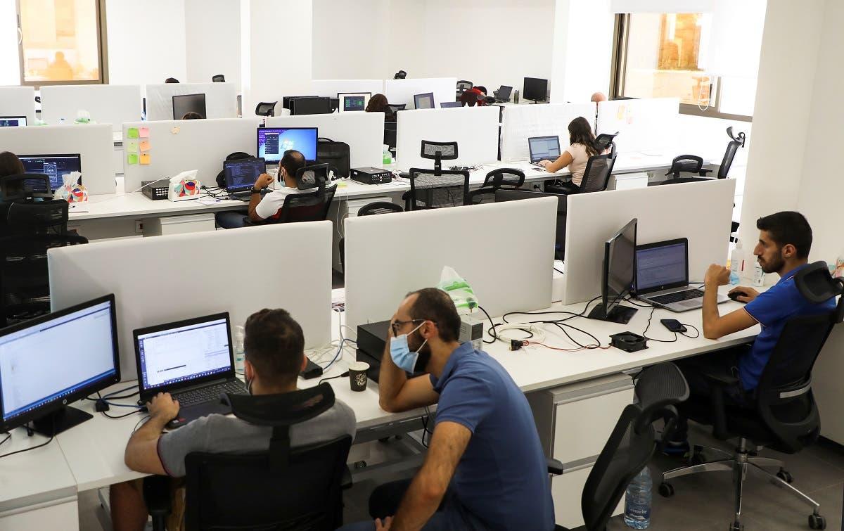 Multilane company's staff work at Houmal technology park in Houmal, Lebanon June 9, 2021. (Reuters/Mohamed Azakir)