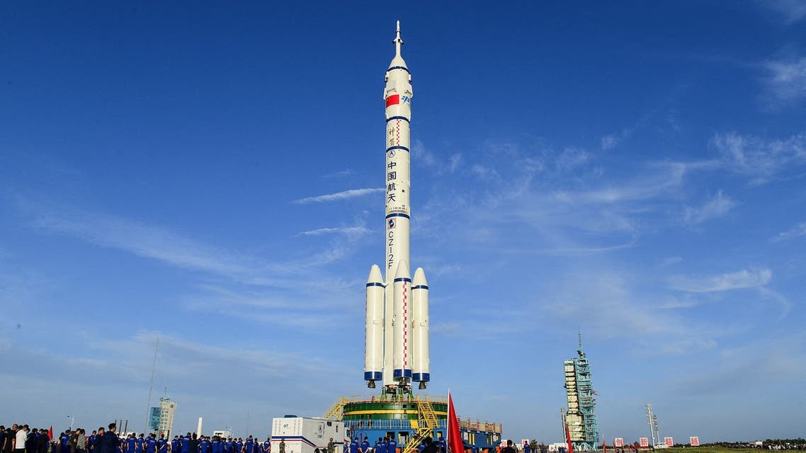 This file photo taken on June 9, 2021 shows a Long March-2F carrier rocket carrying the Shenzhou-12 spacecraft for China's first manned mission to its new space station, scheduled for June 17, at the Jiuquan Satellite Launch Centre in the country's northwestern Gansu province. (File photo: AFP)