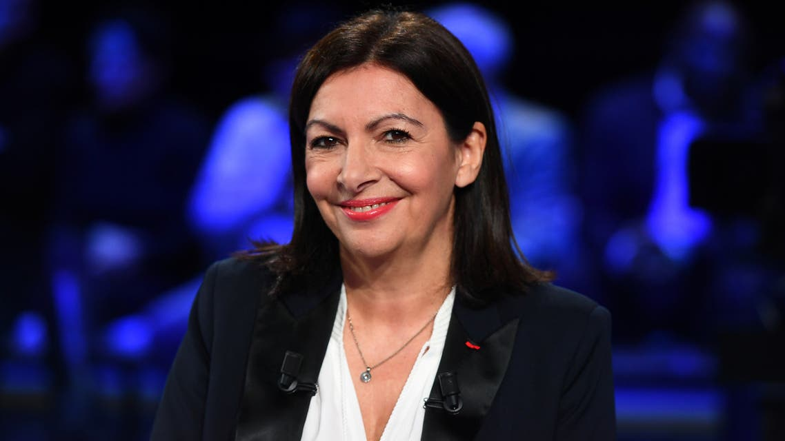 Socialist party's outgoing mayor and candidate Anne Hidalgo arrives on set prior to a debate between seven of the eight candidates running for Paris' city mayor, broadcasted by French public TV and radio news outlet France Info, public TV channel France 3 and public radio station France Bleu Paris, in Paris, March 10, 2020. (Reuters)