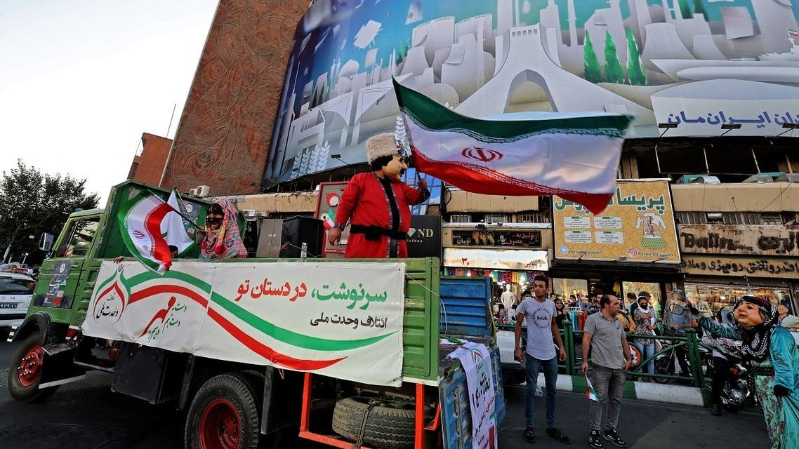 Iranians are called to vote in the upcoming presidential election during a street rally in the capital Tehran on June 15, 2021, three days ahead of the Islamic republic's June 18 vote. (Atta Kenare/AFP)