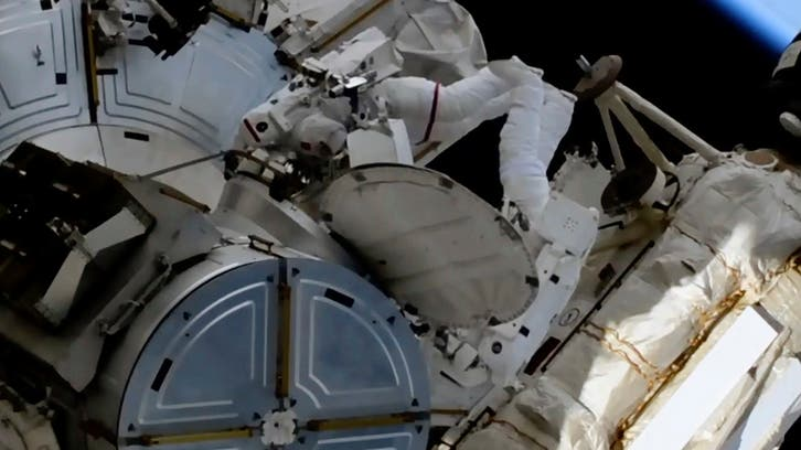 Watch: Astronauts install new space station solar panels in a spacewalk