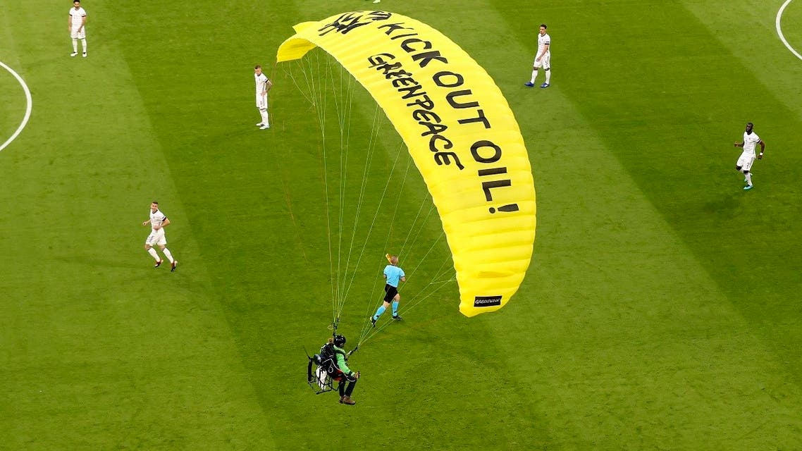 The German players look on as a Greenpeace paraglider lands in the stadium prior to the Euro 2020 soccer championship group F match between France and Germany at the Allianz Arena stadium in Munich, June 15, 2021. (AP/Alexander Hassenstein, Pool)