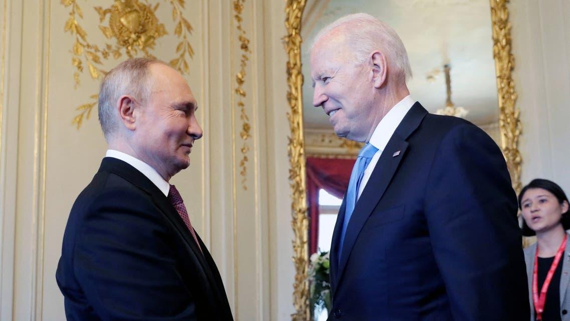 Russian President Vladimir Putin (L) shakes hands with U.S President Joe Biden during their meeting at the 'Villa la Grange' in Geneva, Switzerland in Geneva on June 16, 2021. (AFP)