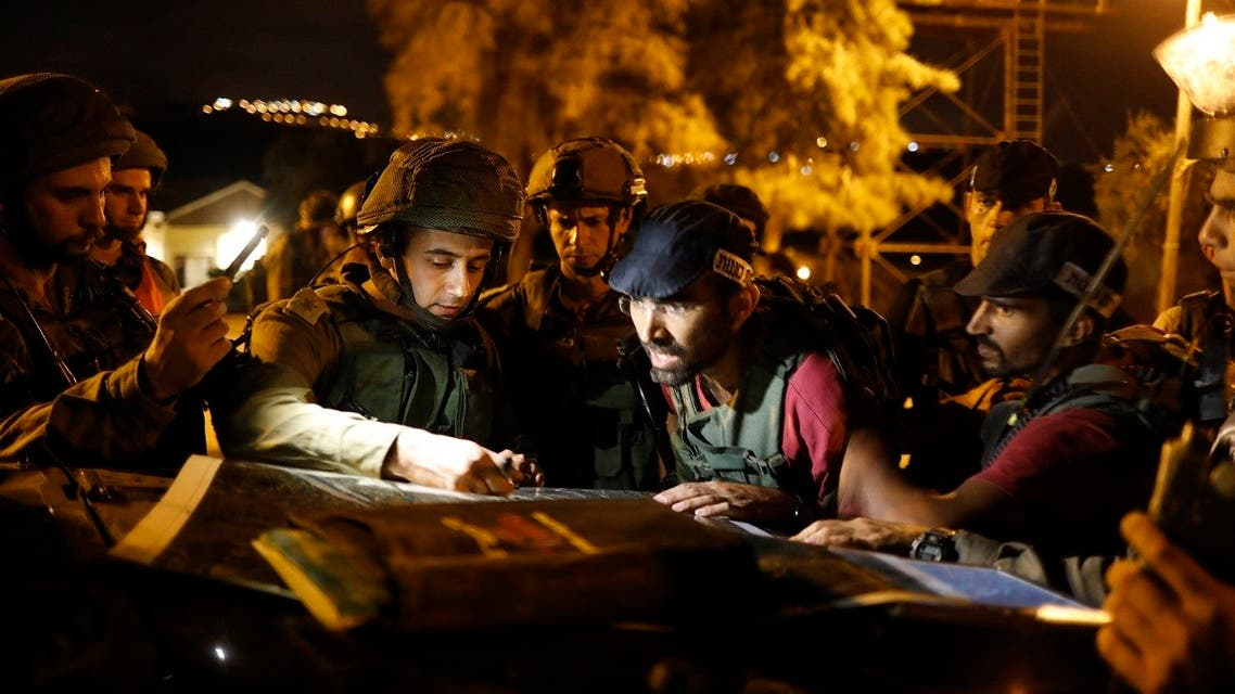 Israeli army officers look at a map in the West Bank Rechelim settlement on August 13, 2018 during an all-night army drill simulating an attack inside an Israeli settlement. (Menahem Kahana/AFP)