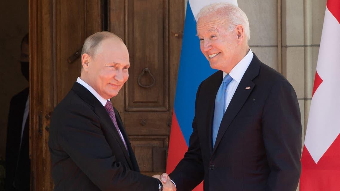 US President Joe Biden (R) and Russian President Vladimir Putin shake hands as they arrive at Villa La Grange in Geneva, for the start of their summit on June 16, 2021. (AFP)