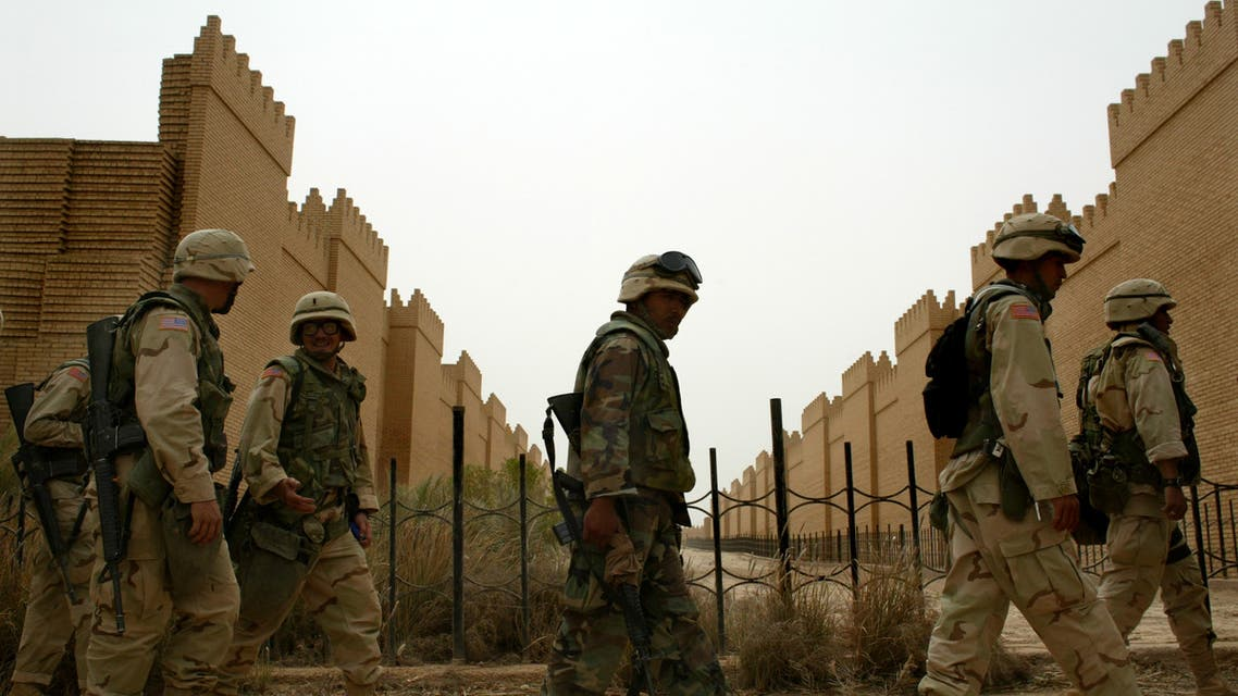 US marines walk through the remake of the palace of King Nebuchadnezzar in the ancient town of Babylon, in this April 20, 2003 file photo. A British Museum report published at the weekend said U.S. troops had caused substantial damage to the ancient city by setting up a military base amid the ruins in April 2003 after invading Iraq and toppling President Saddam Hussein. Polish Defence Minister Jerzy Szmajdzinski said on Monday that contrary to a report by the British Museum, the presence of foreign troops in Babylon had saved the famous archaeological site for civilisation. REUTERS/Jerry Lampen JFL/THI