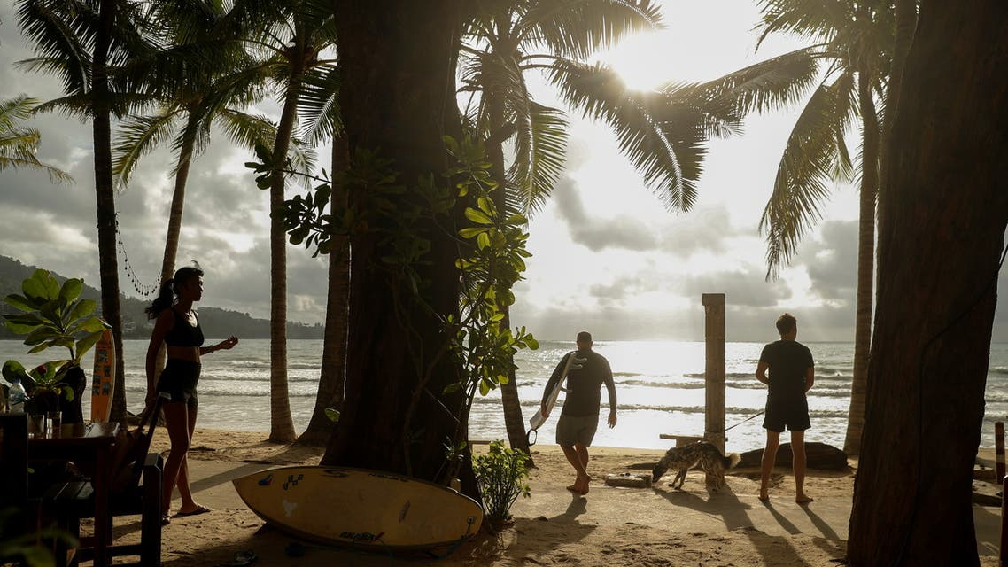 Local residents enjoy Kamala beach on Phuket Island, Thailand in April 2, 2021. Picture taken April 2, 2021. (Reuters)