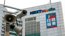 Hong Kong police raid pro-democracy newspaper Apple Daily, arrest five