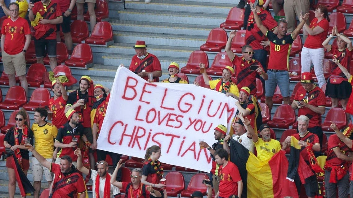 Belgium supporters hold a banner in support of Danish player Christian Eriksen ahead of the Euro 2020 soccer championship group B match between Denmark and Belgium at the Parken stadium in Copenhagen, Denmark, on June 17, 2021. (Reuters)