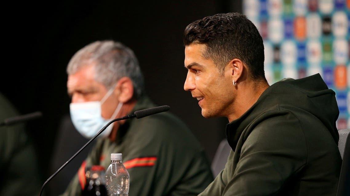 Portugal's Cristiano Ronaldo and Fernando Santos during the press conference. (UEFA/Handout via Reuters)