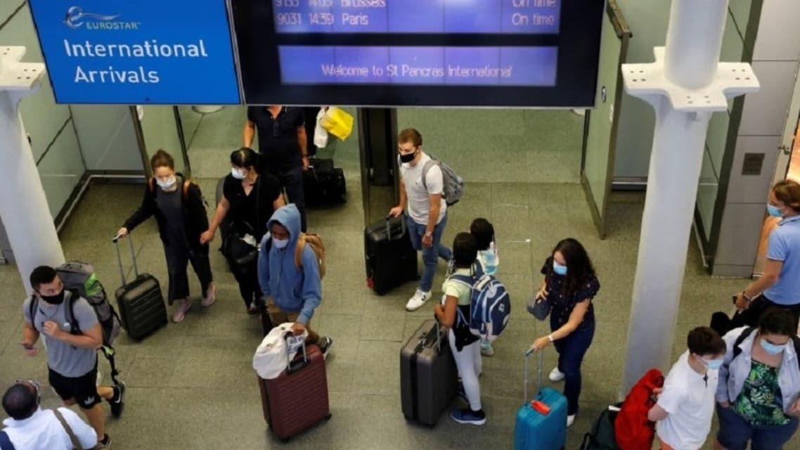 Passengers wear face masks to protect against the coronavirus upon their arrival from Paris to London. (File photo: Reuters)