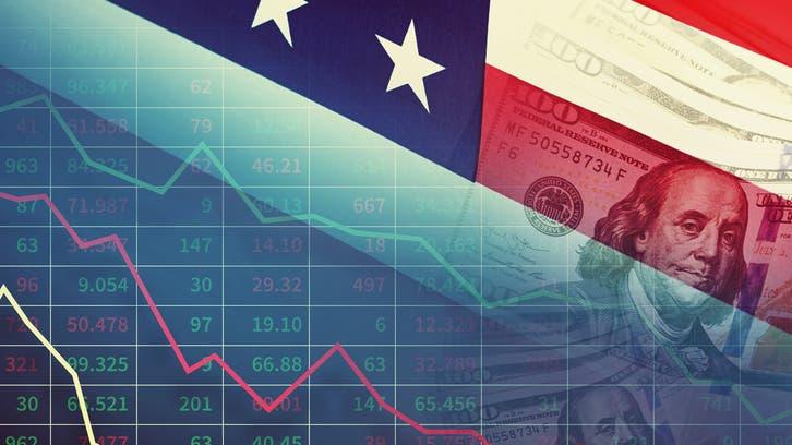لهجة الفيدرالي المتشددة ترفع الدولار وتهوي بالأسهم