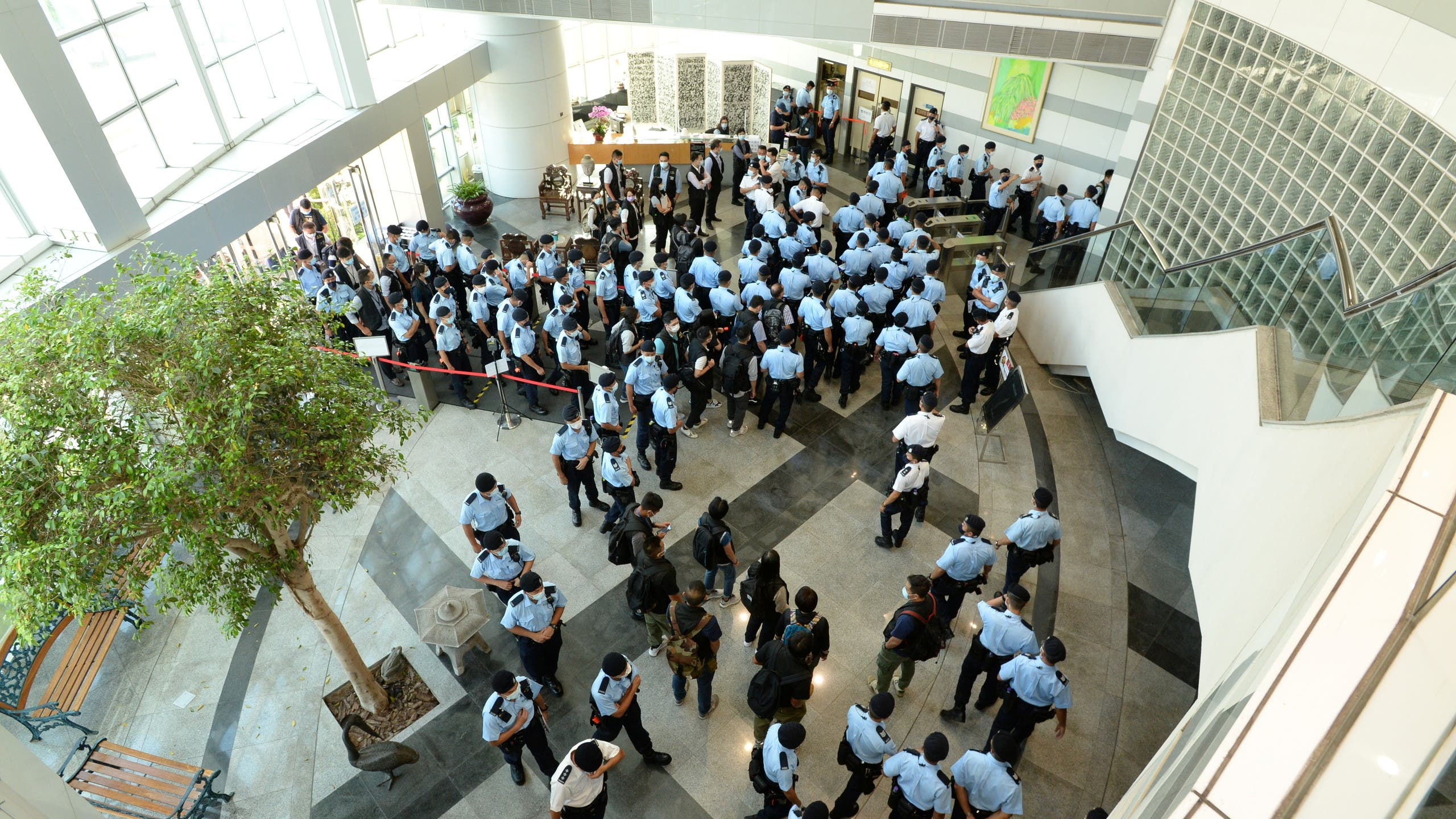 Police officers gather at the headquarters of Apple Daily in Hong Kong, China June 17, 2021. (Apple Daily/Handout via Reuters)