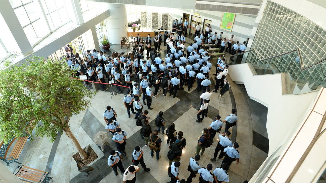 Police officers gather at the headquarters of Apple Daily in Hong Kong, China June 17, 2021. Apple Daily/Handout via REUTERS ATTENTION EDITORS - THIS IMAGE WAS PROVIDED BY A THIRD PARTY. NO RESALES. NO ARCHIVES. HONG KONG OUT. TAIWAN OUT.