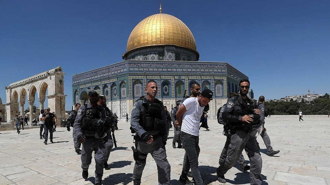 Israeli security force members detain a Palestinian during clashes at the compound that houses Al-Aqsa Mosque, known to Muslims as Noble Sanctuary and to Jews as Temple Mount, in Jerusalem's Old City, on June 18, 2021. (Reuters)