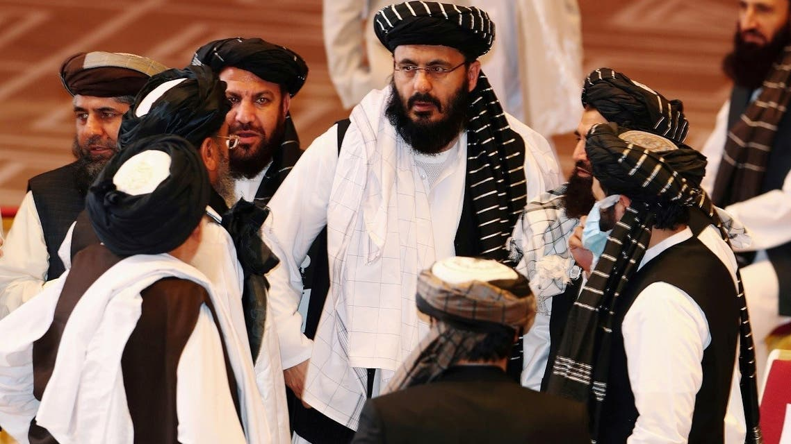 Taliban delegates speak during talks between the Afghan government and Taliban insurgents in Doha, Qatar. (File Photo: Reuters)