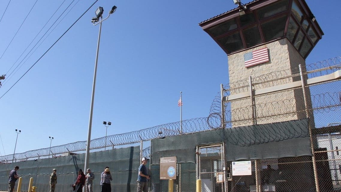 In this file photo taken on January 26, 2017, People walk past the guard tower of Camp 5 at the US Military's Prison in Guantanamo Bay, Cuba. (AFP)