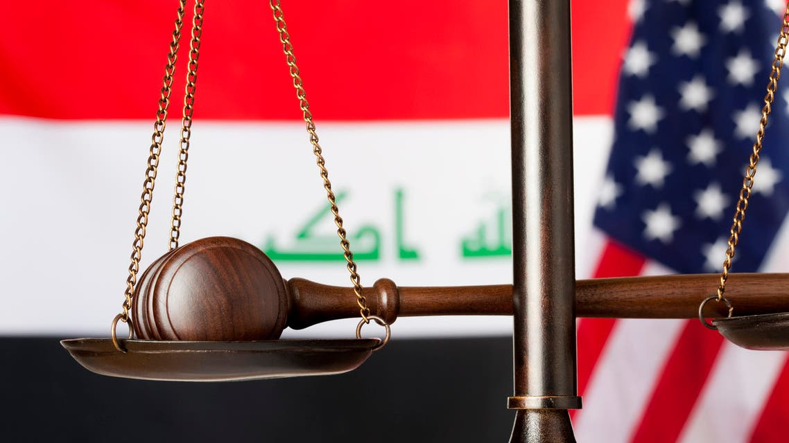 Flags of Iraq and USA in the background. Scale of justice with judge's gavel in front.