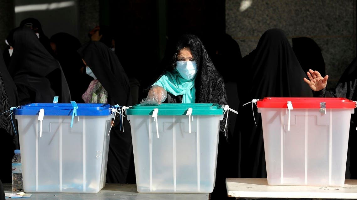 Voters cast their ballots for the presidential election at a polling station in Tehran, Iran, Friday, June 18, 2021. (AP)