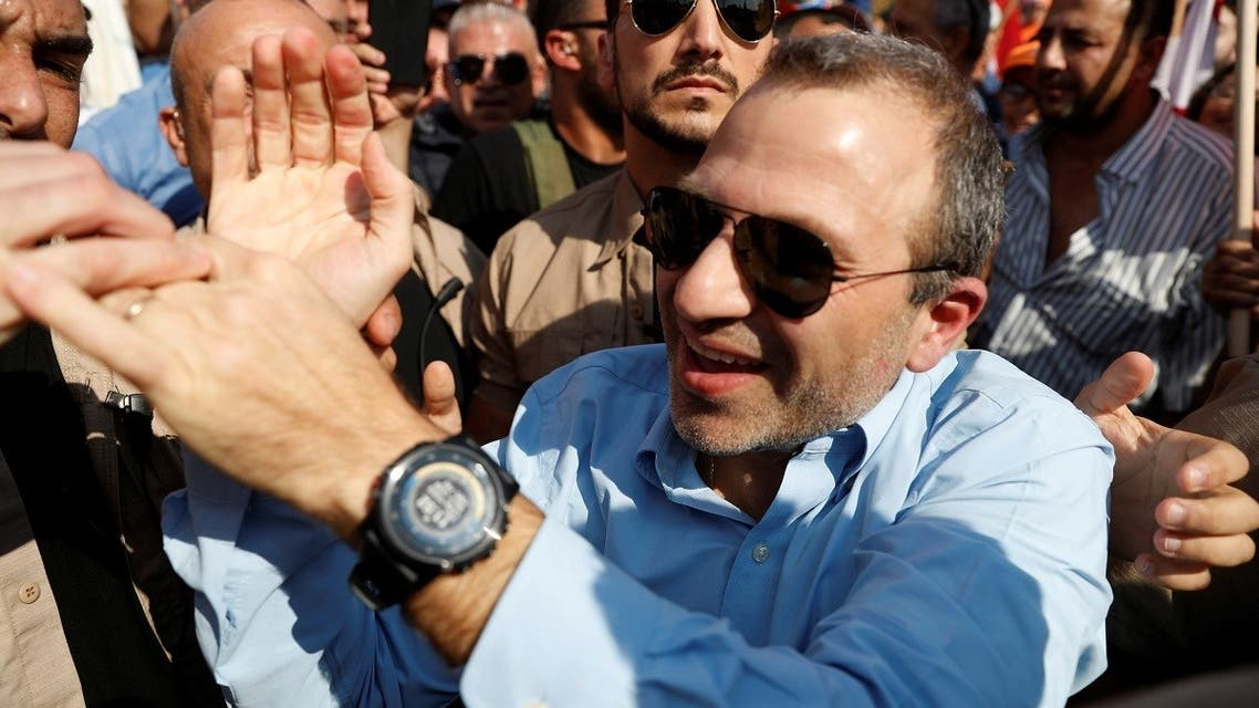 Lebanese MP Gebran Bassil greets his supporters during a rally near Beirut, November 3, 2019. (Reuters)