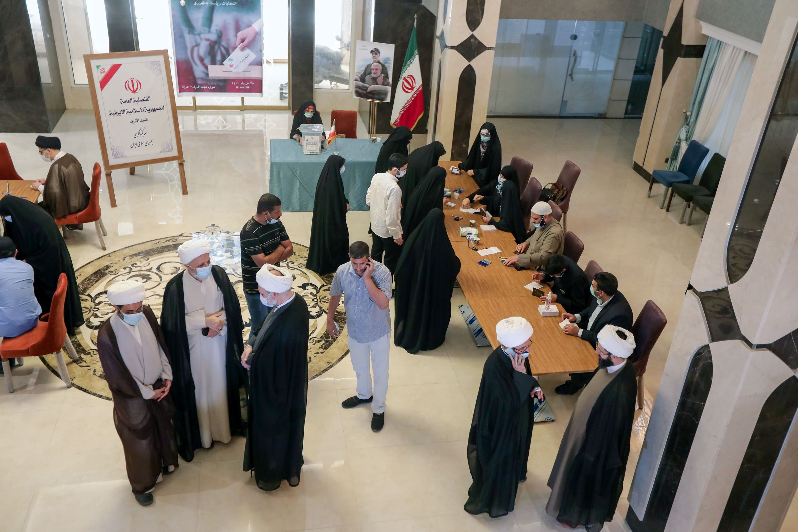Iranian people gather to vote during Iranian presidential election at the Iranian consulate, in Najaf, Iraq, June 18, 2021. (Reuters)