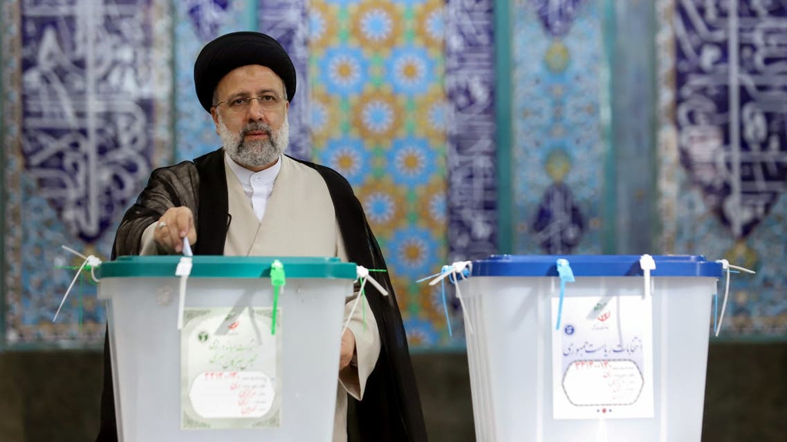 Presidential candidate Ebrahim Raisi casts his vote during presidential elections at a polling station in Tehran, Iran June 18, 2021. (Reuters)