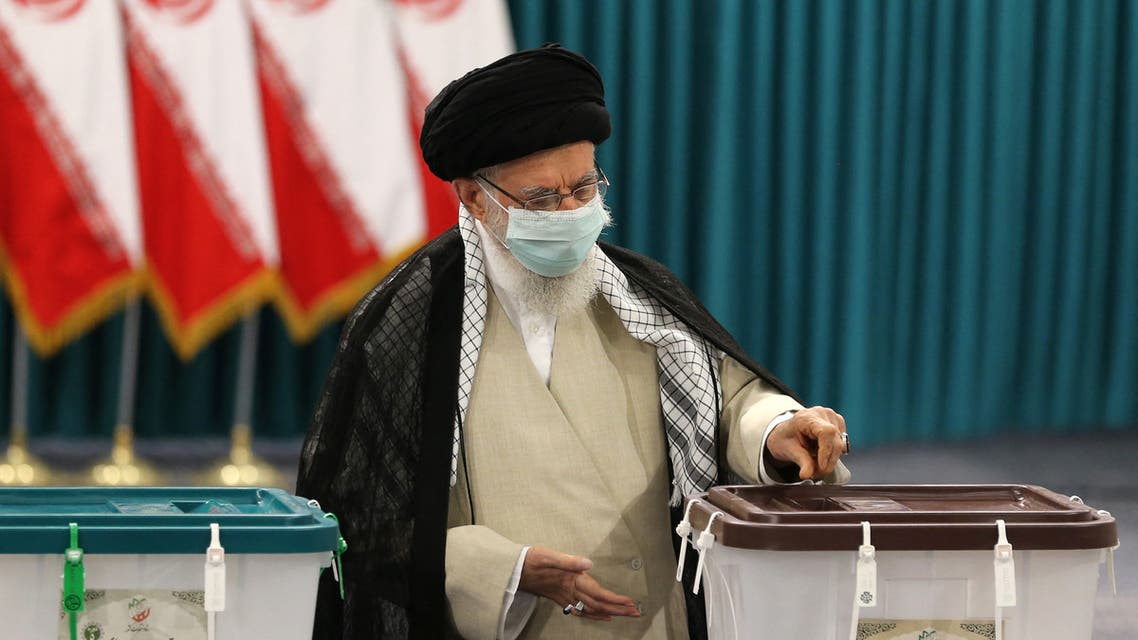 Iran's Supreme Leader Ayatollah Ali Khamenei wears a face mask as he casts his ballot on June 18, 2021, on the day of the Islamic republic's presidential election. (AFP)