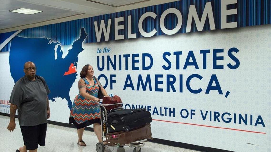 Passengers arrive to the Washington Dulles International Airport. (File Photo: AP)